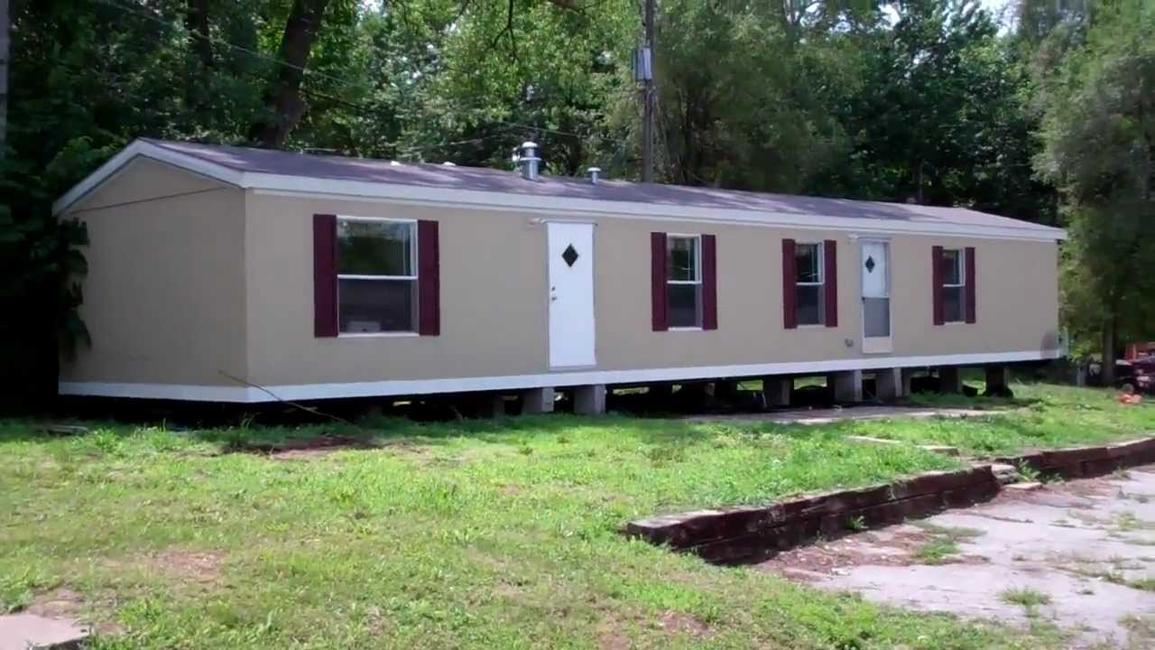 a trailer home that is hitched on the back of a truck
