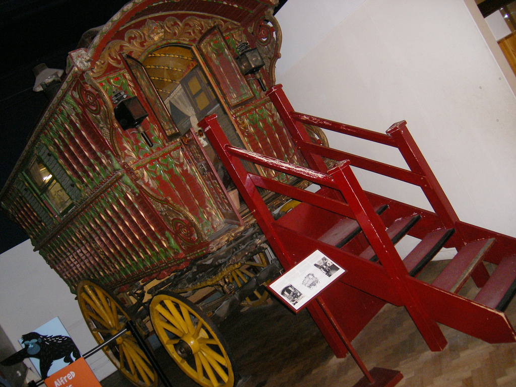 a vardo tiny home or a wagon house displayed in a museum