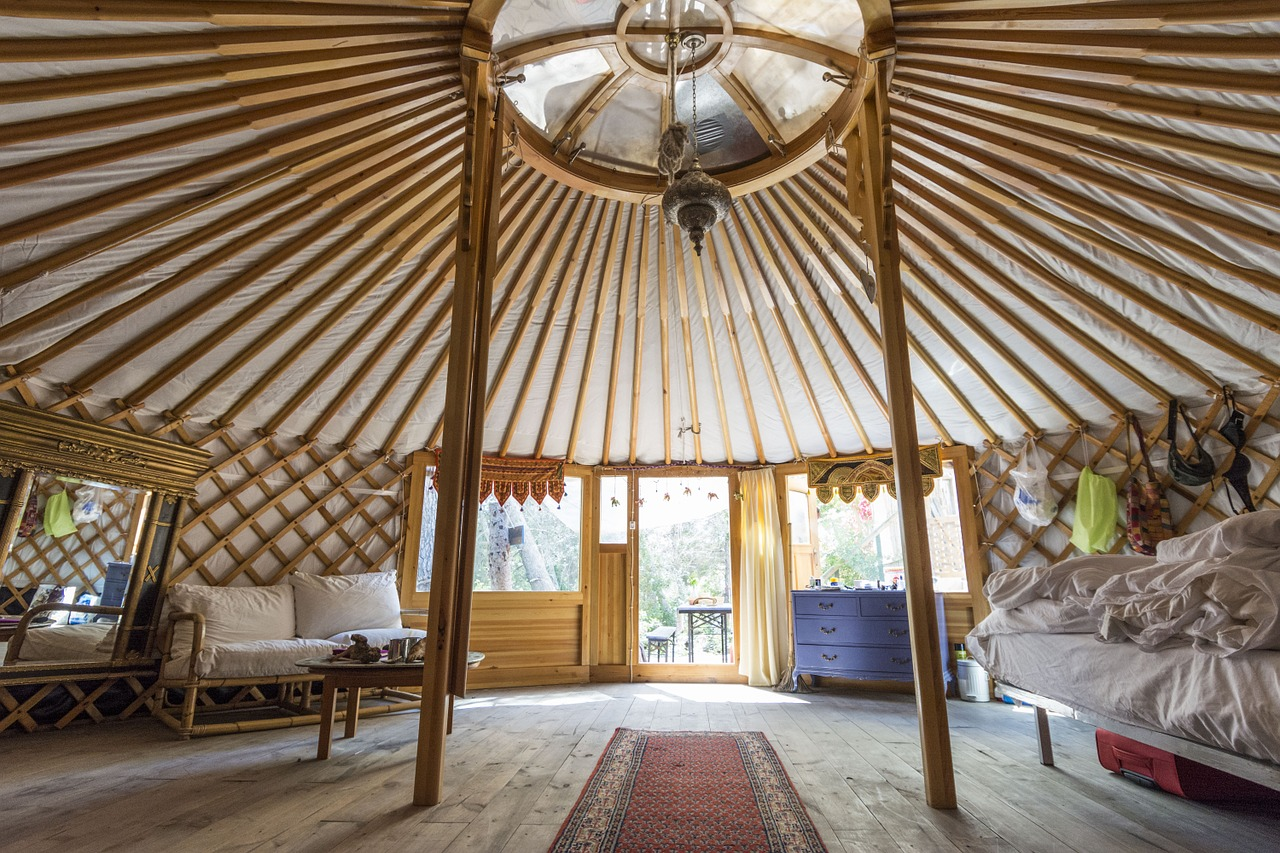the inside of a yurt house made with wooden frames and walls